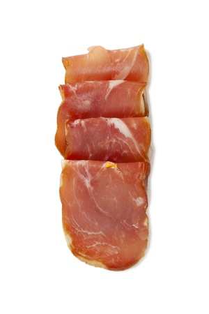 Overhead shot of the fresh prosciutto rolls against the white surface