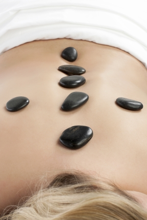 Image of relaxed woman receiving a stone massage on a spa Stock Photo - 16963034
