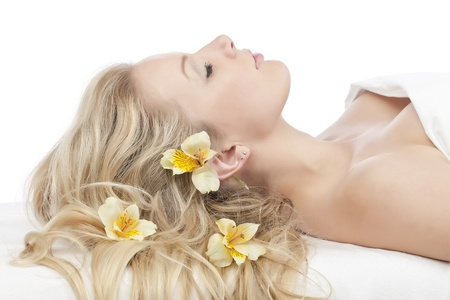 Closed up image of a relaxing woman at spa photo