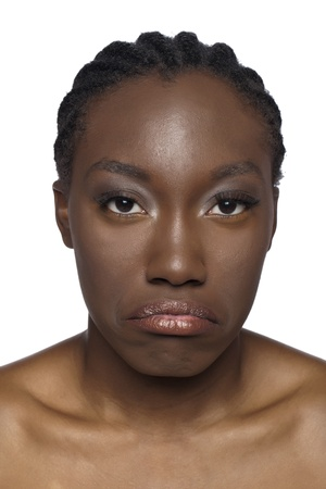 african woman face: Portrait of sad African woman face against white background