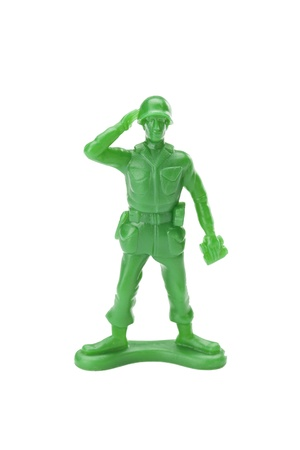 plastic soldier: Saluting toy soldier isolated in a white background