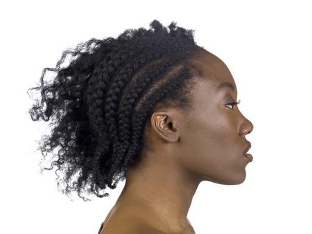 trenzas en el cabello: Vista lateral de tiro de una mujer africana con el pelo trenzado Foto de archivo