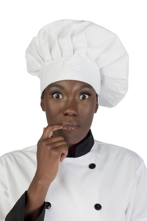 licking finger: Portrait of a surprised female chef licking her finger Stock Photo