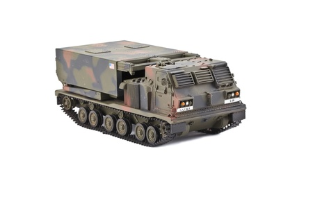 Close up image of toy army vehicle against white background