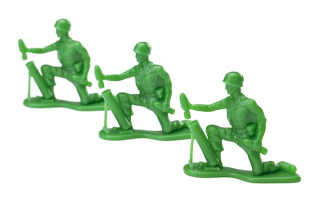Horizontal image of a toy soldiers on an attack concept against white background Stock Photo - 16962924