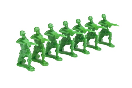 plastic soldier: Troops of green military miniatures isolated on