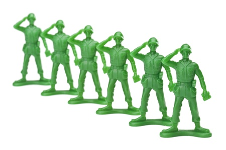 plastic soldier: Troops of in lined military on a salute gesture against white background