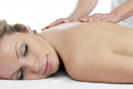 Image of a pretty relaxed woman receiving a back massage on a spa photo