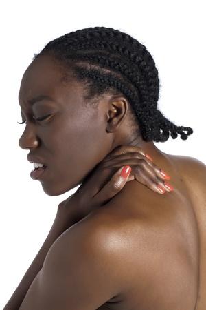 Afrikaanse vrouw die lijdt aan rugpijn Stockfoto