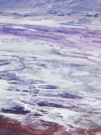 An abstract view of salt flats produce some vivid hues of violet, magenta and blue. Stock Photo - 16977898