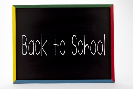 Back to school written in small students slate board. Stock Photo - 16982295