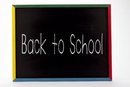 slateboard: Back to school written in small students slate board.