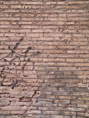 Old european weathered and worn wall with graffitti. Stock Photo - 16978672
