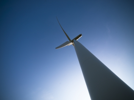 Low angle view of a wind powered electric generator with blue sky in the background. Stock Photo - 16973139
