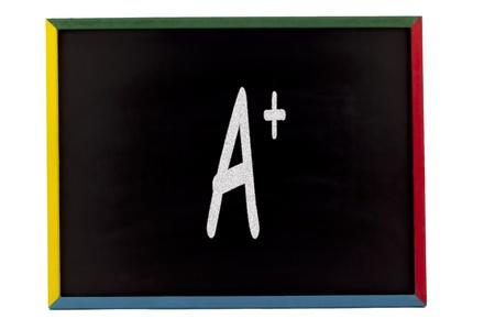 slateboard: A+ written on slateboatrd over white background.