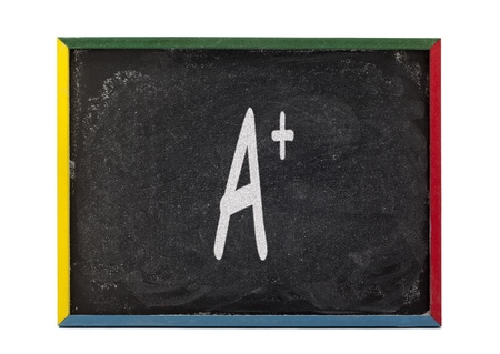slateboard: A+ written on small students slate board and displayed on white background.