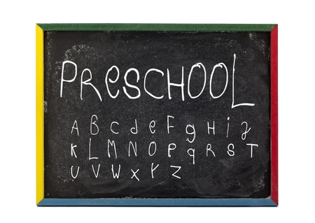 slateboard: Alphabet and preschool written on slate board and displayed over white background. Stock Photo