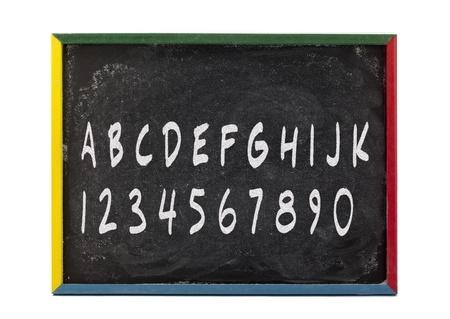 slateboard: Alphabet letters and numbers written on slate board over white background. Stock Photo