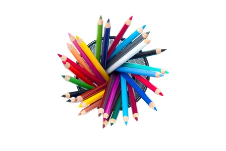 overwhite: Birds eye view of colourful pencil crayons isolated on a white background.