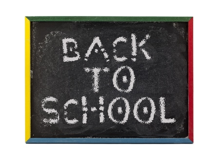 slateboard: Back to school written on small students chalk board and displayed on white background. Stock Photo