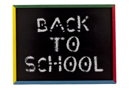 slateboard: Back to school written on small students slate board and displayed on white background. Stock Photo