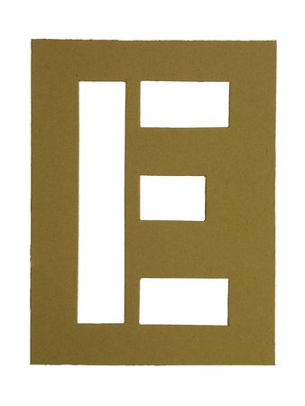 Close-up image of a cardboard with cut out letter E against the white surface photo