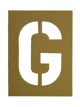 Close-up image of a cardboard with cut out letter G photo