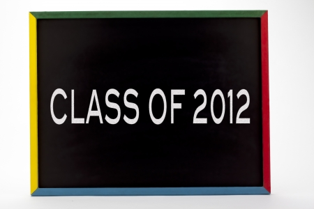 slateboard: Class of 2012 written on slate board and displayed on white background.