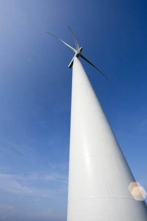 Low angle view of a wind mill with blue sky in the background. Stock Photo - 16975909