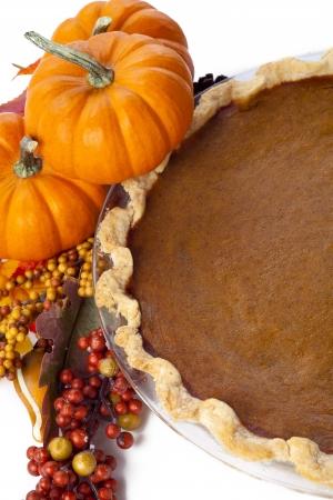 pumpkin pie: Pumpkin pie on table isolated on white.