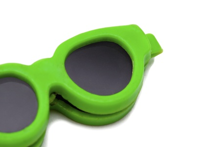 Cropped image of green sunglasses displayed on white background. Stock Photo - 16982182
