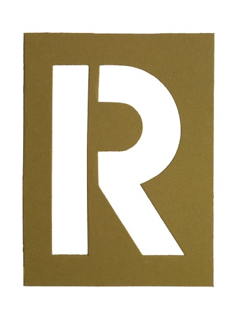 Golden cardboard with cut out letter R photo