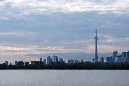 Long distant shot of cityscape with sea in foreground. Stock Photo - 16976544