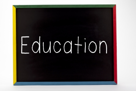 slateboard: Education written on small students slate board and displayed on white background.
