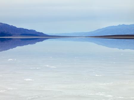 The Salt Flats mirror an image of a mountain.