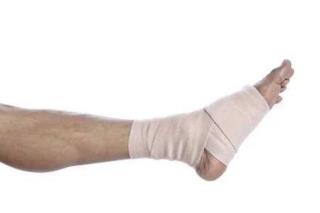 tensor: Close up image of mans foot with a tensor bandage against a white background