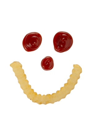 tomato catsup: Smiling face made of french fries and ketchup against white background Stock Photo
