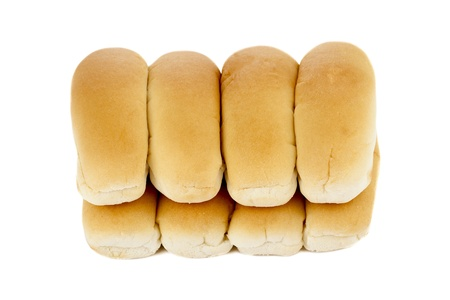 newly baked: Horizontal image of freshly baked hotdog bread against the white surface Stock Photo