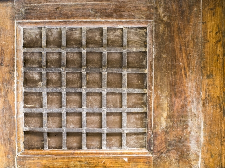 Grating window on a vintage wall Stock Photo - 16973430