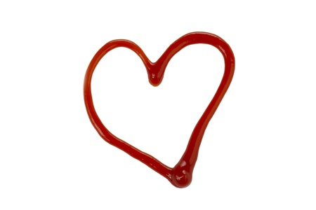 tomato catsup: Close up image of a heart shape made of ketchup against white background Stock Photo