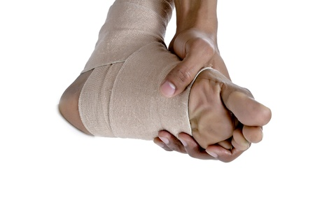 articulation: Closed up man holding his injured feet