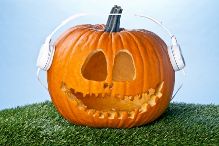 Jack O Lantern expressing love for music by wearing a headphone. photo