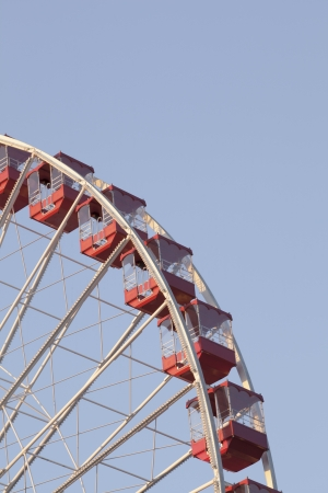 Low angle cropped image of ferris wheel against clear sky. photo