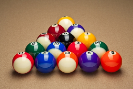 Close-up shot of pool balls arranged in triangle on pool table  photo