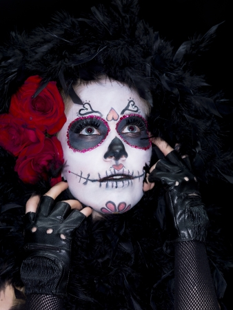 mexican folklore: Close-up shot of a woman wearing scary sugar skull make-up looking up  Stock Photo