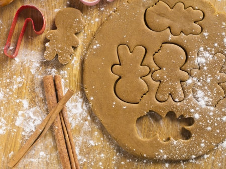 Detailed shot of gingerbread dough and cookie cutter  photo