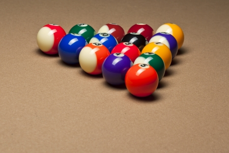 pool ball: Macro shot of shiny pool balls arranged on pool table  Stock Photo
