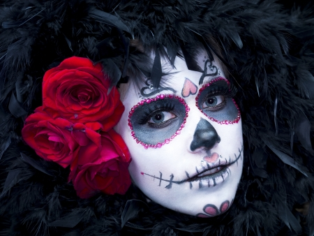 Close-up portrait image of a scary female wearing traditional folk art with roses and fur  photo