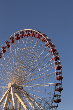 Low angle cropped image of giant wheel against clear sky  photo