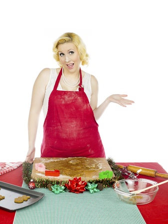 Image of a happy young woman gesturing while making Christmas cookies, Stock Photo - 16974596